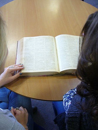 A-level students using a 1785 dictionary during an outreach workshop