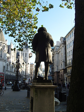 Statue of Johnson outside St Clement Danes church looking down Fleet Street past the Royal Courts of Justice