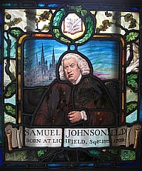 Stained glass portrait of Johnson with Lichfield cathedral in the background and a border of leaves and acorns with a book at the top