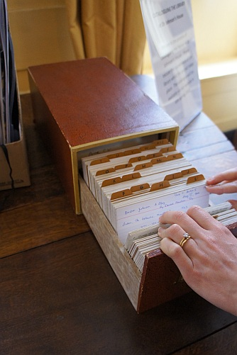 Person filing through the library catalogue card index